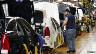 A General Motors assembly worker works on the production line for the 2011 Cadillac at the Grand River Assembly plant in Lansing, Michigan