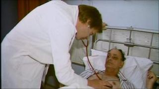 Doctor using stethoscope on patient