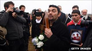 Mourners at the funeral of Robert Csorba and his son, killed in an attack in 2009