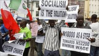 Trade union members display placards during a protest, in Lagos, Nigeria, Wednesday 10 November 2010