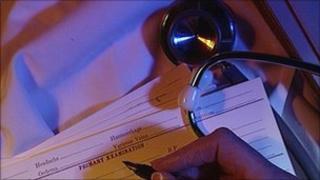 GP filling out medical form