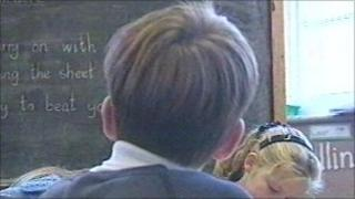 Boy looking at blackboard