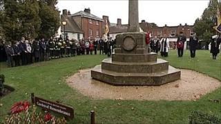 People standing at war memorial in Wimborne