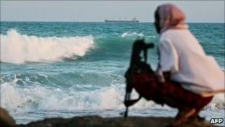 Pirate keeps watch off Somali coast (file image)