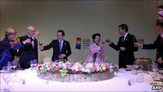 """This handout on November 12, 2010 shows EU President Herman Van Rompuy (2nd L), South Korea""""s President Lee Myung-bak (3rd L), Lee""""s wife Kim Yoon-ok (3rd R) andSpain""""s Prime Minister Jose Luis Rodriguez Zapatero (2nd R) during a dinner of the G20 Summit"""
