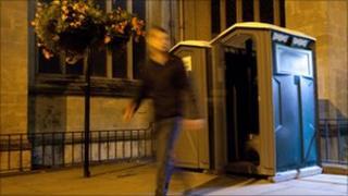 Man leaving portable toilet