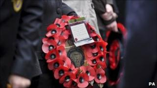 Man holding Royal British Legion wreath