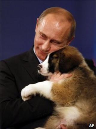 Russian Prime Minister Vladimir Putin cuddles a Bulgarian sheepdog