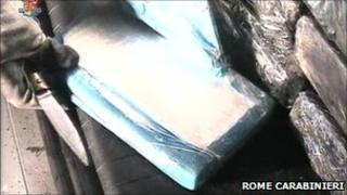 Italian police open one of the packages containing cocaine discovered in a container unloaded at Gioia Tauro port in southern Italy, 15 November 2010