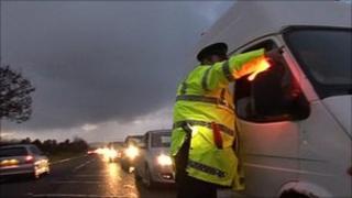 DVA official talking to van driver