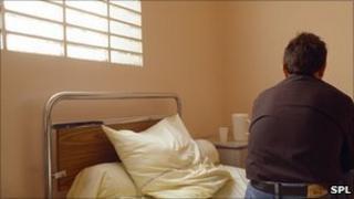 Depressed man in a psychiatric ward (posed by model)