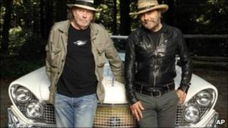 Neil Young, left, and record producer Daniel Lanois with the hybrid car