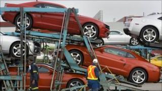 General Motors workers load Chevrolet Camaros at the company's Oshawa Ontario facility in Canada