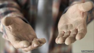 A man's hands reaching out