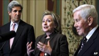 Hillary Clinton standing alongside John Kerry (left) and Richard Lugar
