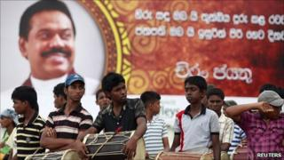 Boys with drums wait to take part in a dress rehearsal for President Mahinda Rajapaksa's second term swearing in ceremony at the presidential secretariat building in Colombo 17 November, 2010.