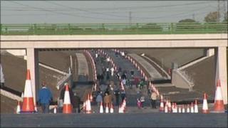 People walking on new Alderley Edge bypass