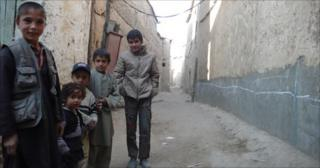 Children play in the streets of Charikar