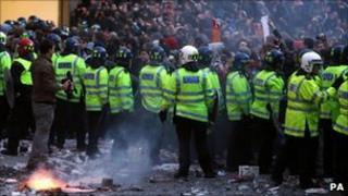 Protesters face police at Millbank, central London