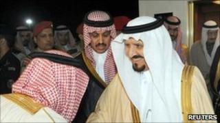 Crown Prince Sultan bin Abdul Aziz is greeted by officials at King Khalid airport in Riyadh