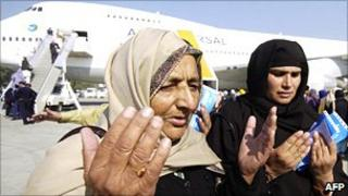 Pakistani Muslims ready to depart from Lahore airport for the annual Hajj in Saudi Arabia