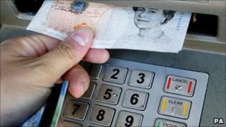hand taking money from cash machine