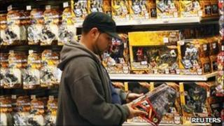 A man shops for toys at the Toys R Us store at Times Square in New York