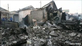 Destroyed houses are seen after they were hit by artillery shells fired by North Korea on Yeonpyeong Island
