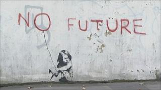 "Painting believed to be by Banksy of a child sitting under the words ""no future"""