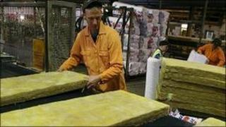 Man rolling fibre glass
