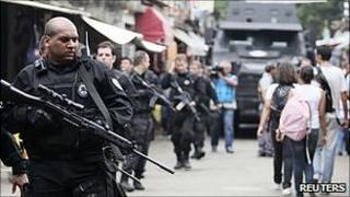 Police patrol the Jacarezinho slum in Rio de Janeiro. 24 Nov 2010