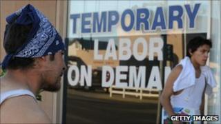 Unemployed man waits outside a temporary labour office in El Centro, California