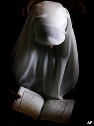 A Muslim woman reads the Koran