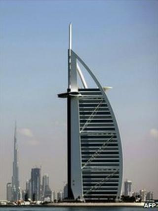 Two of Dubai's most prominent architectural icons Burj al-Arab Hotel (C) and Burj Khalifa (L) along the coast of the Gulf emirate