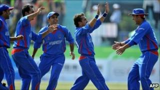 Afghan players celebrate the dismissal of Pakistani batsman Muhammad Azeem in the semi final