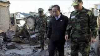 Kim Tae-young (centre) inspects damage to Yeonpyeong island, before his resignation - 25 November.