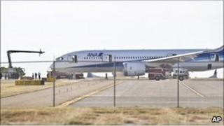 The Dreamliner is examined by emergency services and investigators.