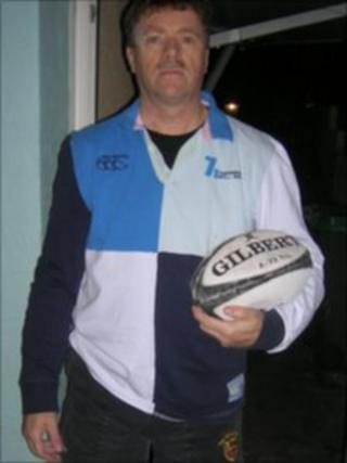 Stephen Clee holding a rugby ball