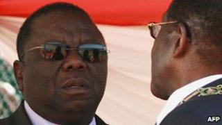 Zimbabwean President Robert Mugabe (C) and his wife Grace (R) chat with the Prime Minister Morgan Tsvangirai (L) at the National Sports Stadium in Harare on August 10, 2010