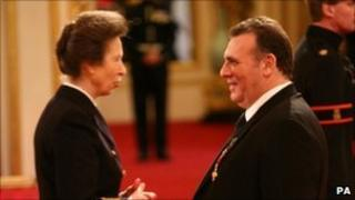 Graham King and the Princess Royal at Buckingham Palace
