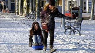 Two girls enjoy the snow in Edinburgh