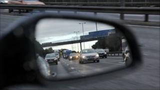Car with cars shown in wing mirror