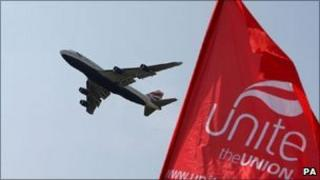 A BA plane takes off over a Unite picket line near Heathrow Airport during a previous strike in May this year