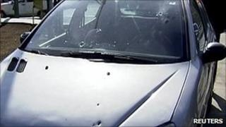 Bullet marks one of the scientist's cars (image from AlAlam TV)