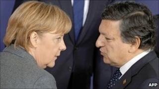 European Commission President Jose Manuel Barroso (right) talks to German Chancellor Angela Merkel, 28 Oct 10