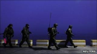 South Korean marines patrol on Yeonpyeong Island, which was shelled by North Korea last week