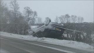Overturned car on Leicestershire road