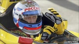 Russian Prime Minister Vladimir Putin at the wheel of a car from the Renault Formula One team near St Petersburg, 7 November