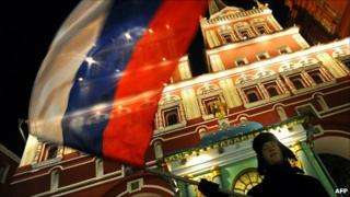 A man waves the Russian national flag in Moscow