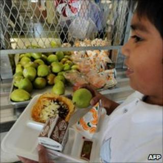 Child picks up a school lunch in Los Angeles, California, on 2 Dec.